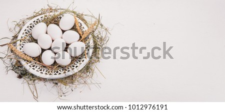 Chicken raw eggs on a metal plate. On a wooden background. Top view. Copy space. #1012976191