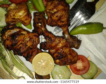 Chicken Roast in plate | This is a Picture of ''Chicken Roast'' that shows the leg pieces of a chicken meat which are roasted.They have brown colored when roasted.high resolution in HD quality.
