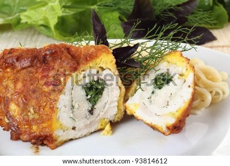 Chicken rolls stuffed greens close up shoot
