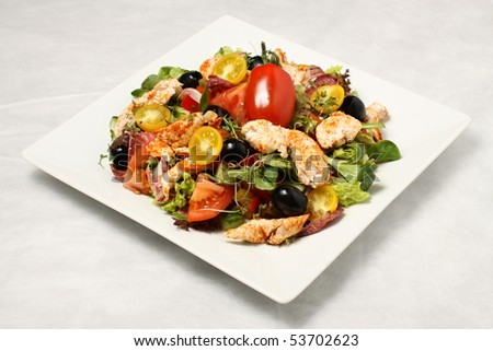 Chicken salad on the white plate