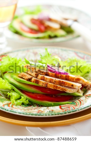 Chicken salad with avocado and tomatoes - stock photo