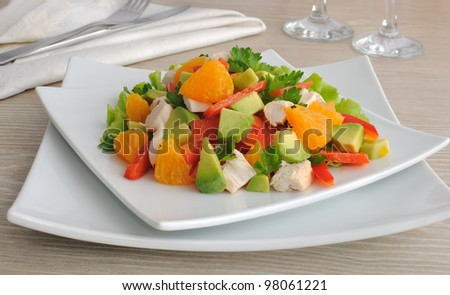 Chicken salad with avocado, sweet pepper and orange - stock photo