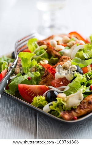 Chicken salad with black olives and garlic sauce
