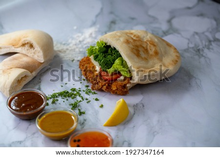 chicken schnitzel sandwich in pita bread. A Mediterranean delicacy famous street food in Israel  Stockfoto ©