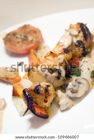 chicken shish kebab on skewer in mushroom sauce as photographed in Monte Carlo Monaco - stock photo