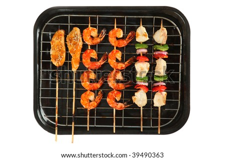 Chicken Shrimp Vegetable Skewers on Stove Pan