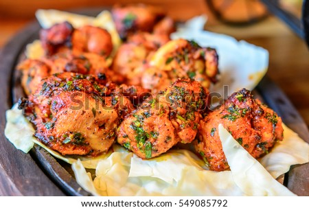 Chicken skew Kebab.Traditional Indian dish cooked on charcoal and flame, seasoned & colorfully garnished served with fresh lettuce