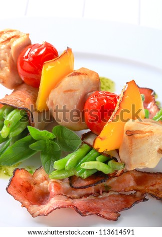 Chicken skewer and bacon-wrapped green beans