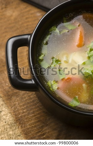 Chicken soup in the ceramic bowl