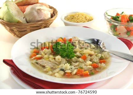 Chicken soup with chicken and fresh vegetables
