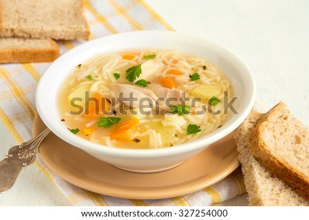 Shutterstock Chicken soup with noodles and vegetables in white bowl