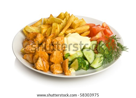 Chicken stew with fried potato, sauce and vegetables. Isolated on white.