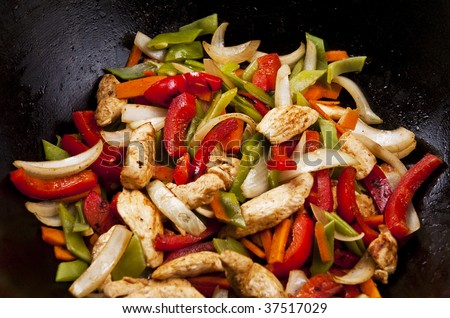 Chicken Stir Fry With Red Peppers Onion And Green Beans Stock Photo ...
