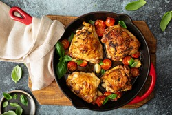 Chicken thighs roasted with tomatoes and garlic, quick dinner dish recipe