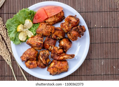 Stock photo of chicken tikka kebab with vegetables  on plate top view