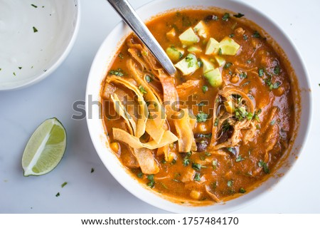 Photo of  Chicken Tortilla Soup - chicken and tortillas in spicy broth