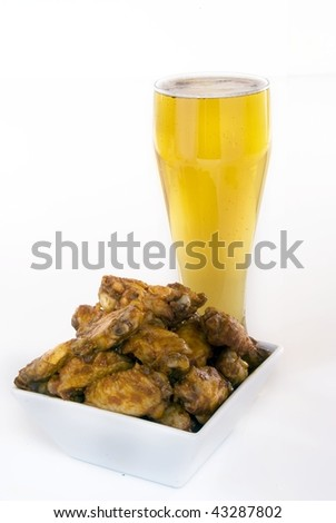 Chicken wings and beer against white