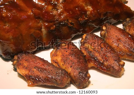 Chicken Wings Barbequed with ribs on the side