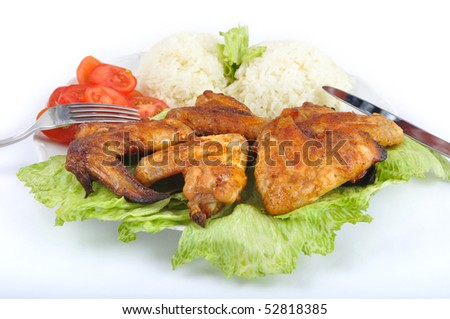 stock-photo-chicken-wings-with-rice-vegetable-and-cutlery-52818385.jpg