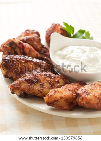 Chicken wings with sauce, selective focus