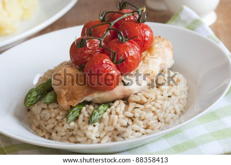 Chicken with basmati rice and roasted cherry tomatoes