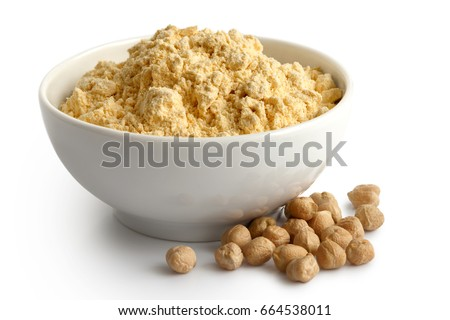 Chickpea flour in white ceramic bowl isolated on white. Spilled chickpeas. #664538011