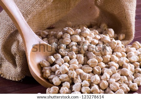 Chickpeas in a wooden spoon and bag