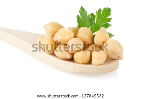 chickpeas over wooden spoon on white background.