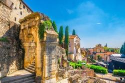 Chiesa dei Santi Siro e Libera catholic church, Roman Theater Archaeological Museum Museo Archeologico with ruins, Piazza del Foro square, Verona city historical centre, blue sky, Veneto Region, Italy
