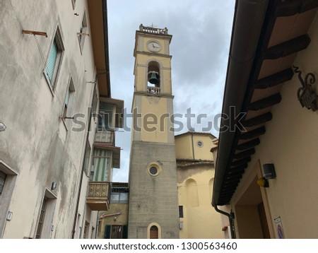 Chiesa dei Santi Stefano e Giovanni Evangelista (Church of Saints Stephen and John the Evangelist) in the small village of Castelnuovo della M.dia, province of Livorno  Stock fotó ©