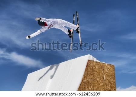 CHIESA VALMALENCO, ITALY - MARCH 31, 2017: Freestyle Ski FIS European Cup, athlete jump