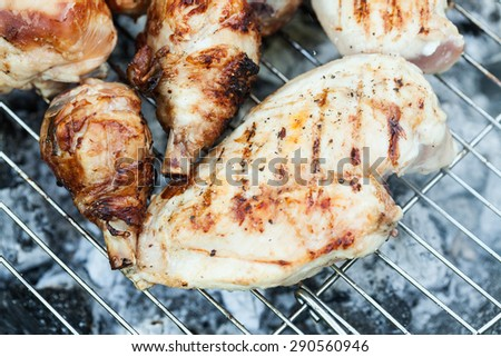 Chiken on the grill - paleo food photography with shallow depth of field. #290560946