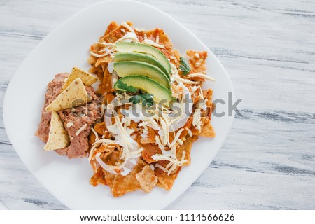Chilaquiles rojos with chicken and avocado mexican food mexico breakfast