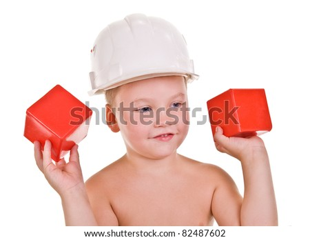 child a builder.boy with red blocks on a white background