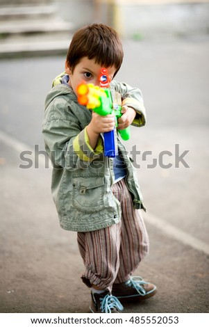 Child aiming toy rifle. Ready steady fire