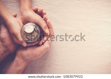 child and adult holding money jar, donation, saving, charity, family finance plan concept, Coronavirus economic stimulus rescue package, superannuation concept