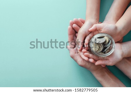 child and adult holding money jar, donation, saving, charity, family finance plan concept, Coronavirus economic stimulus rescue package, superannuation concept