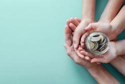 child and adult holding money jar, donation, saving, fundraising charity, family finance plan concept, Coronavirus economic stimulus rescue package, superannuation concept