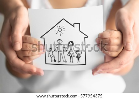 Child and adult person holding drawing of house with family, closeup. Adoption concept #577954375