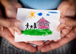 Child and his mom holding a drawn house with family. Close up. Vignette.