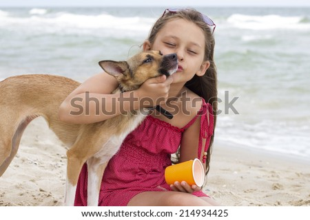 Child and puppy on the beach