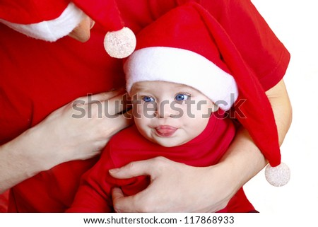Child and the man in the costumes of Santa Claus.