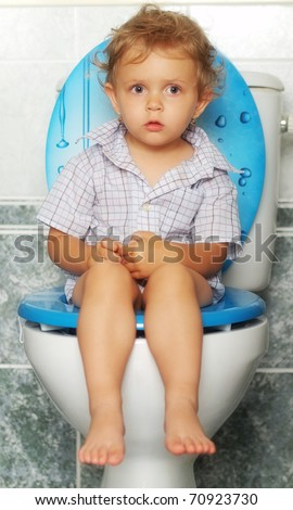 Child and toilet