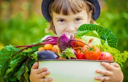 Child and vegetables. Selective focus.