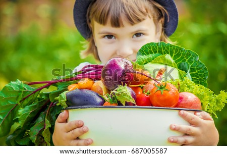 child and vegetables. selective ...