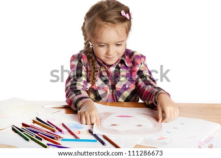 Child - artist paints with colored pencil drawing in a checkered shirt on a white background
