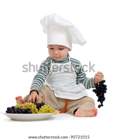 child as chef with grape over white background