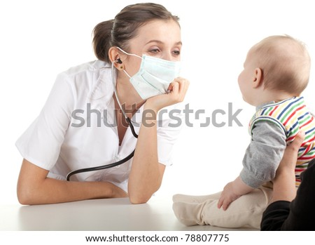 child at doctor - female doctor examining baby boy - stock photo