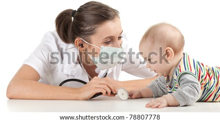 child at doctor - female doctor examining baby boy