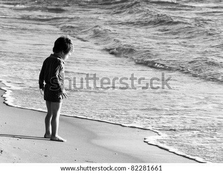 child at the sea, black and white shoot